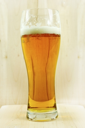 Glass of Beer on Wood. Glass of Light Fresh Beer Vertical Photo.