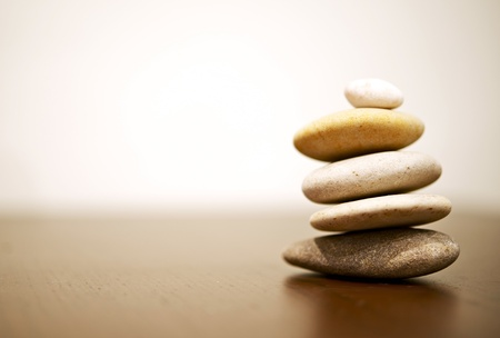 Balance Rocks on Wood Table. Stack of Round Smooth Stones. Stock fotó