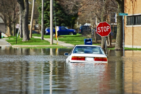 flood damage: Car Under Water  Vehicle Flooded by River Flood in Des Plains, IL, USA  Flooded City Streets After Few Days of Intense Rain  Nature Disasters Photo Collection  Stock Photo