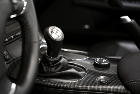 shifting: 6 Speed Stick Shift - Modern Vehicle Interior in Black and White  Powerful Engine and Six Speed Transmission  Transportation Photo Collection