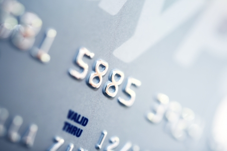technology transaction: Credit Card Number Closeup. Banking and Transaction Technology. Credit Card in Macro Photography.