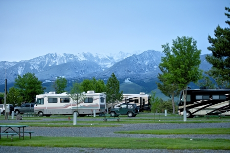 campsite: RV Park in Montana. Recreation Vehicles in the RV Park. Montana Mountains on the Horizon. Montana RV Trip.