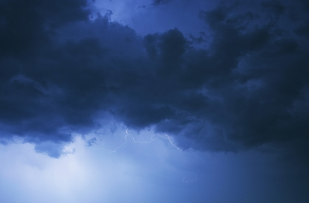 Stormy Night Sky. Cloudy Stormy Clouds Illuminated by Lightnings. Severe Weather Photography Collection.