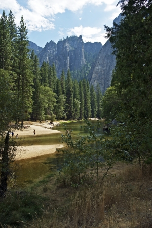 granite park: Yosemite Scenery in Vertical Photography. Summer in Yosemite National Park. People in the River Having Fun. American National Parks Photography Collection. Stock Photo