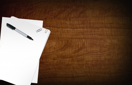 designer: Blank Papers on Wood Desk. Black Marker. Copy Space Composition Stock Photo