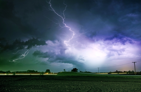 windy energy: Tornado Alley Severe Storm at Night Time. Severe Lightnings Above Farmlands in Illinois, USA. Severe Weather Photography Collection.