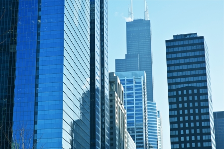 commercial real estate: Modern American Cityscape. Glassy Skyscrapers of Chicago, Illinois, USA. American Architecture Photo Collection.