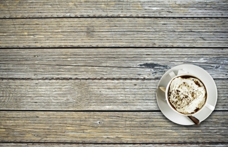 Tasty Coffee Cup on the Wood Planks Table. Top View  Copy Space. Coffee Break. Food and Drink Collection. photo