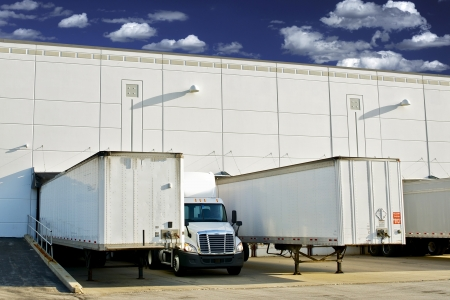 Warehouse Loading Docks - Business District. Semi Trucks and Trailers Loading. Shipping and Logistics Photography Collection.