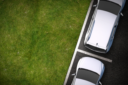 parked: Road Side Parking - Cars Parked on the Side of the Road. Grass Field Copy Space. Top View. Transportation Illustration. Stock Photo
