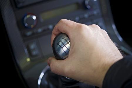 Driving Stick Shift - Hand on the Stick. Manual Car Transmission. Transportation Collection. Banco de Imagens