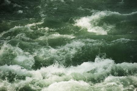Raging Water Background. Raging Mountain River Closeup. Nature Collection. 版權商用圖片
