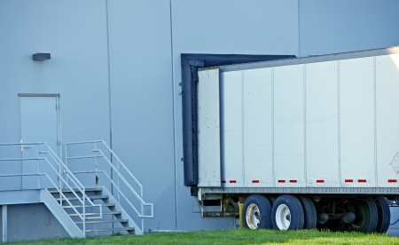 loading truck: Semi Truck Delivery. Truck Trailer in Warehouse Dock.