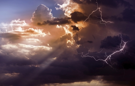 Beautiful Storm During Sunset. Lightnings Between Clouds During Storm. Weather Photo Collection. photo