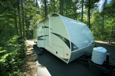 camper trailer: Travel Trailer in RV Park. Recreation Vehicle in the Cascades National Park RV and Camping Area. Washington State, USA. Recreation Collection.
