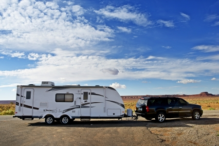 recreational vehicle: RV Trailer Journey. Travel Trailer Pulling by Large Sport Utility Vehicle in Arizona USA. RV Adventures. Recreation Photo Collection.