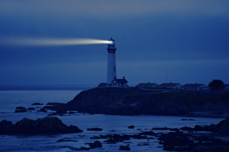 illuminated: Lighthouse in California. Pigeon Point Lighthouse, CA, USA.  Pacific Ocean Cost Landscape. Lighthouse at Night.