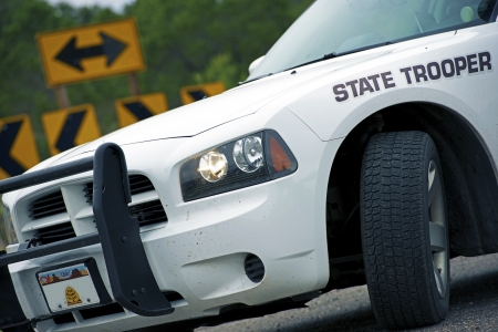 Police Cruiser State Trooper on a Highway. United States of America Police. Imagens