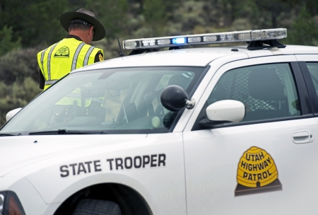 trooper: Utah State Trooper Cruiser. Police Car and Trooper. Police Photo Collection. Editorial