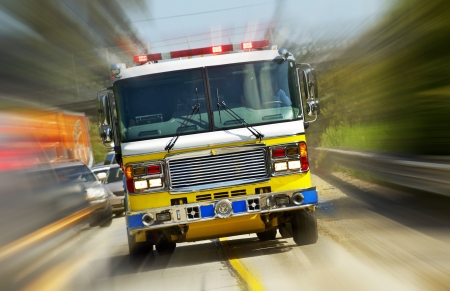 engine fire: Fire Truck in Action - California, USA. Fire Department at Work. Flashing Lights of Fire Truck. Transportation Collection. Stock Photo