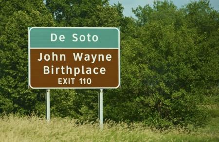 john wayne: John Wayne Birthplace - De Soto  Highway Sign  Stock Photo