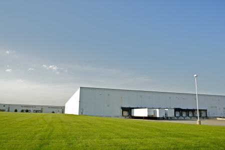 Industrial Zone - Warehouses with Truck Gates and Green Field  Industrial Collection  photo