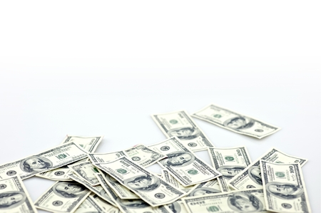 scamming: Laying Money - Laying One Hundred Dollar Bills Isolated on White. Money Photo Collection.