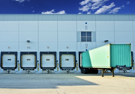 Trailer in a Dock  Warehouse Building with Gates  Business and Logistics Photo Collection Stok Fotoğraf