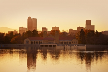 denver skyline with mountains: Denver City Park in Sunset. Denver, Colorado, USA. Lake Reflections. Downtown Denver. American Cities Collection.
