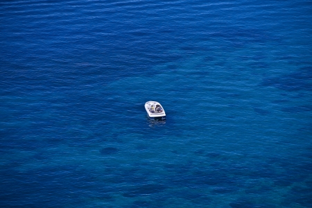The Boat. Motorboat in the Middle of Blue Water of Lake Tahoe, California, United States. Recreation Photo Collection. photo