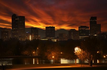 denver parks: Reddish Sunset in Denver. Red Cloudscape Above Downtown Denver Skyline. Denver, Colorado, United States. Stock Photo