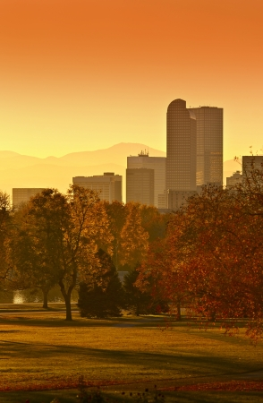 Sunny Denver Sunset. Denver Skyline with Mountains in Background. Denver, Colorado, United States. photo