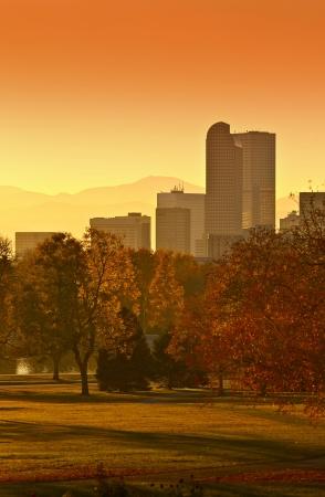 denver skyline at sunset: Sunny Denver Sunset. Denver Skyline with Mountains in Background. Denver, Colorado, United States.