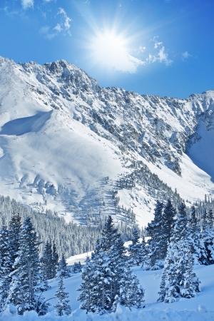 basin mountain: Winter Alpine Landscape. Colorado Rocky Mountains Under the Snow. Beautiful Sunny Winter Day at Arapahoe Basin, Colorado, United States. Stock Photo