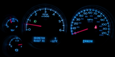 momentum: Car Dash Instruments on Black. Vehicle Dashboard Closeup. Stock Photo