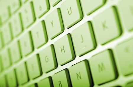 computerize: Computer Keyboard in Green Color Grading. Keyboard Closeup.