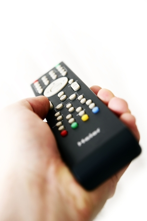 parental control: TV Remote Control in Hand Isolated on White. Television Remote Controller.