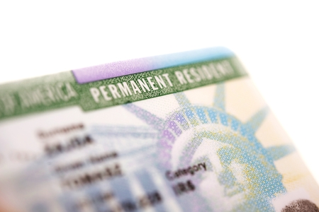 naturalization: American Green Card - United States Permanent Residency Card Closeup.