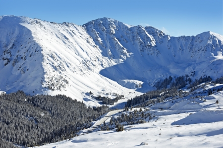 rocky mountains colorado: Snow Mountain Peaks. Arapahoe Basin, Colorado, United States. Winter Landscape
