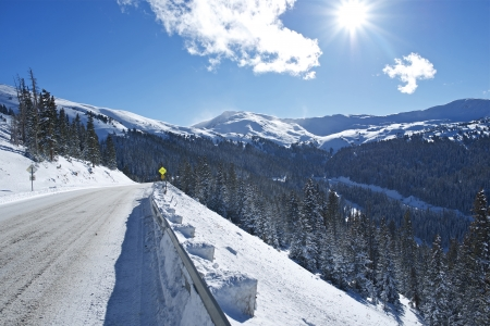 winter road: Winter Drive in Colorado. Mountain Road Covered by Snow and Ice. Colorado, United States. Stock Photo