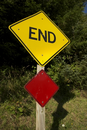 end road: End Road Sign on Wood Pole. Bankruptcy Concept Stock Photo