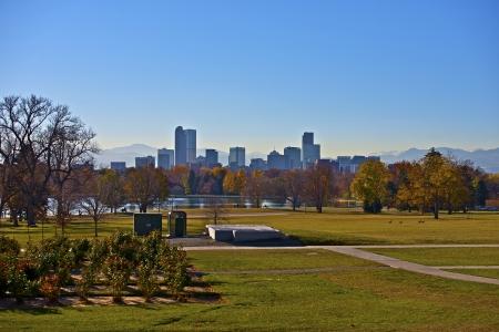 denver city park: Denver City Park and Downtown Denver Skyline with Mountains in Background. Colorado Urban Landscape Stock Photo