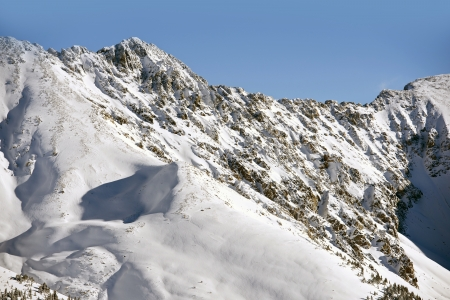 basin mountain: High Rocky Mountains Peaks in a Winter Time. High Colorado Mountains Alpine Landscape Stock Photo