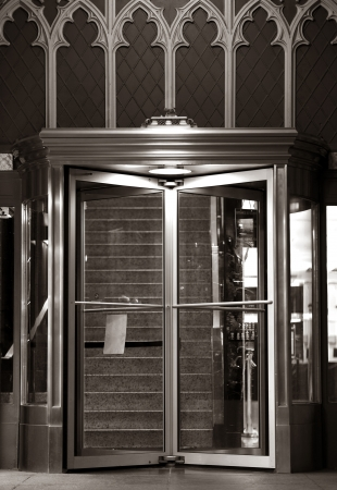 rotate: Elegant Residential Building Entrance Doors. Rotating Doors. Architecture Details. Stock Photo