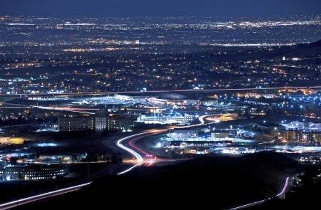 denver: Denver Metro Area at Night. Golden and Lakewood Area Illumination at Night Panorama. Stock Photo
