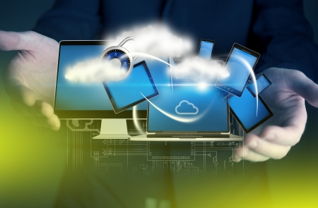 laptop screen: Multimedia Business Concept. Businessman with Some Devices and Cloud Connections. Abstract Technology and Business Concept
