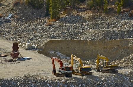 Small Gold Mine Operation. Excavators and Small Sluice Box. 版權商用圖片