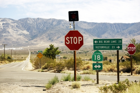 bear lake: South Eastern California Countryside Roads Crossing. Big Bear Lake and Victorville Sign. Stock Photo
