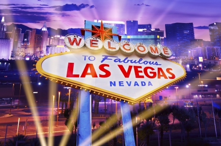 Las Vegas Showtime Concept. Illuminated City and Vegas Strip Welcome Sign. Famous City of Las Vegas, Nevada, United States. photo