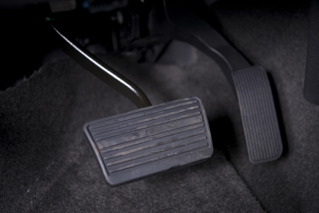 automatically: Automatic Transmission Car Pedals Closeup. Gas and Break Pedals.